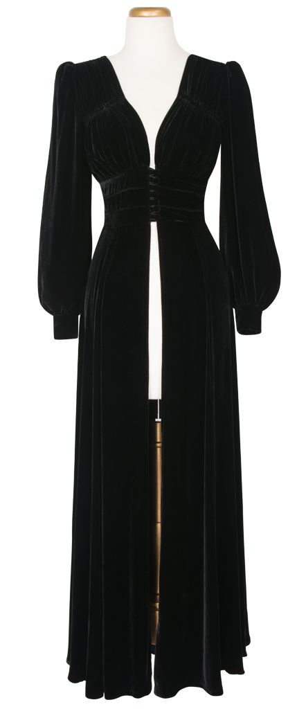 A brand new design, the 1940's Long Robe is a stunning, ankle-length gown that's bound to become a fan favorite. Combining the bodice of our 1940s Button Blouse with the long, billowing sleeves of the Bianca Dress, this robe is the perfect fusion of elegance and sophistication. With a three-panel structured waist for a flattering vintage silhouette and a deep v-neck to accentuate your decolletage, the gown opens at the front with petite covered buttons. The long length skirt splits from the…