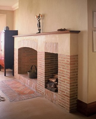 Great double fireplace and also herringbone pattern of klompies (lanes ceramics)
