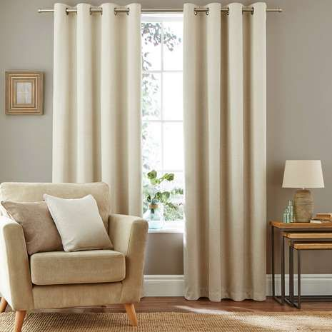 Designed with a herringbone pattern, these blackout curtains are finished in a natural colour, feature an eyelet header for easy fitting and feature a thick bla...
