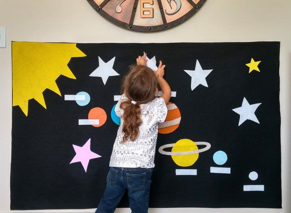 Toddler learning, Montessori style. HUGE Felt Space Wall. Kids create their own scene! AND for good cause - EmIsCrafty.com: Buy a craft, feed a baby.