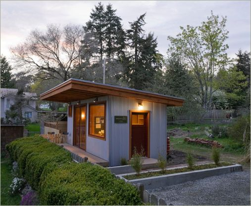 Clad in corrugated metal siding and a sod roof, this guest studio/office fits easily in an eclectic neighborhood on Bainbridge Island. When it is fully grown, a stand of bamboo will screen the parking area from the office.