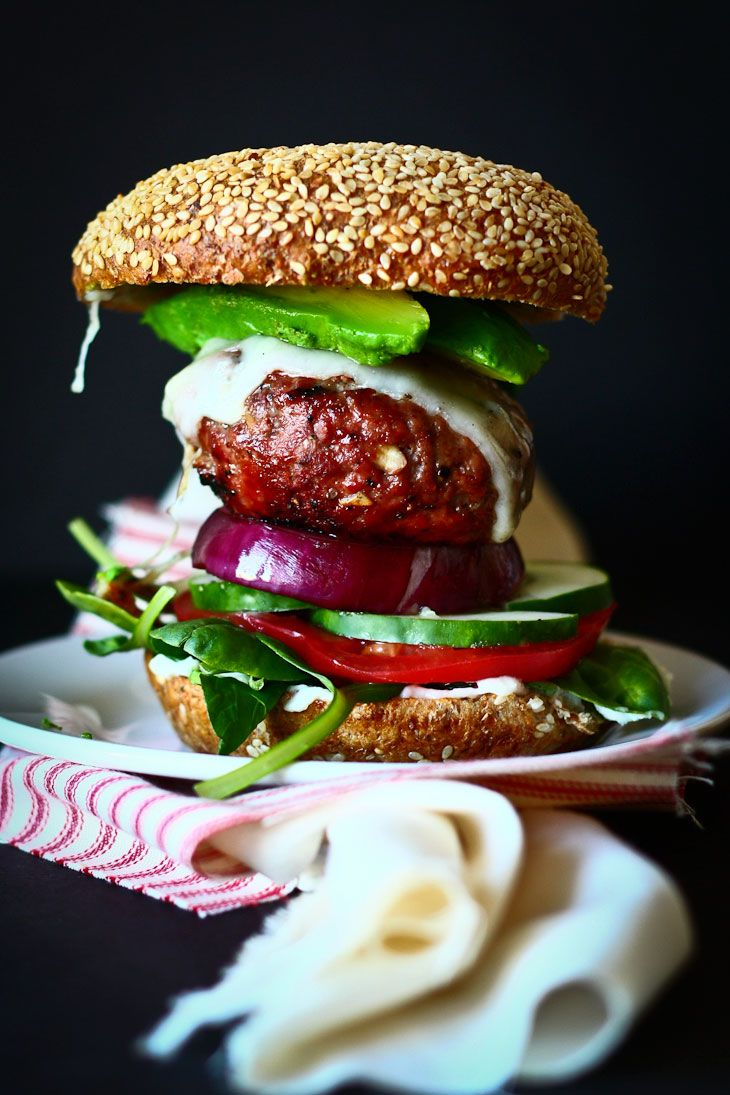The ultimate burger: Nourish yourself with 100% grass-fed ground beef, grilled California avocado, fancy truffle cheese, grilled red onion,ta-soi greens, crunchy cucumber, sliced heirloom tomatoes with a healthy smear of ketchup, mustard (of the yellow variety please- though dijon sounded good too,) slabbed between sprouted buns.