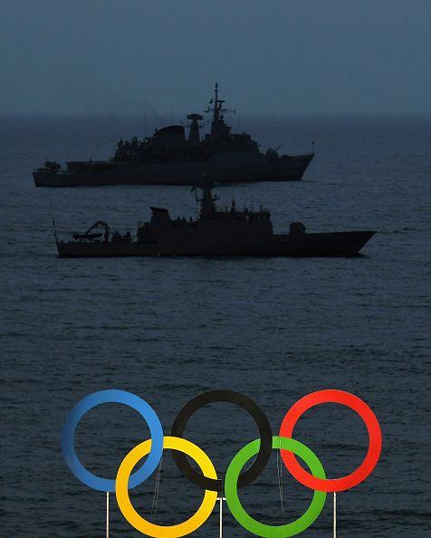 Naval vessels are seen behind the Olympic Rings on Day 2 of the Rio 2016 Olympic Games at the Beach Volleyball Arena on August 7 2016 in…