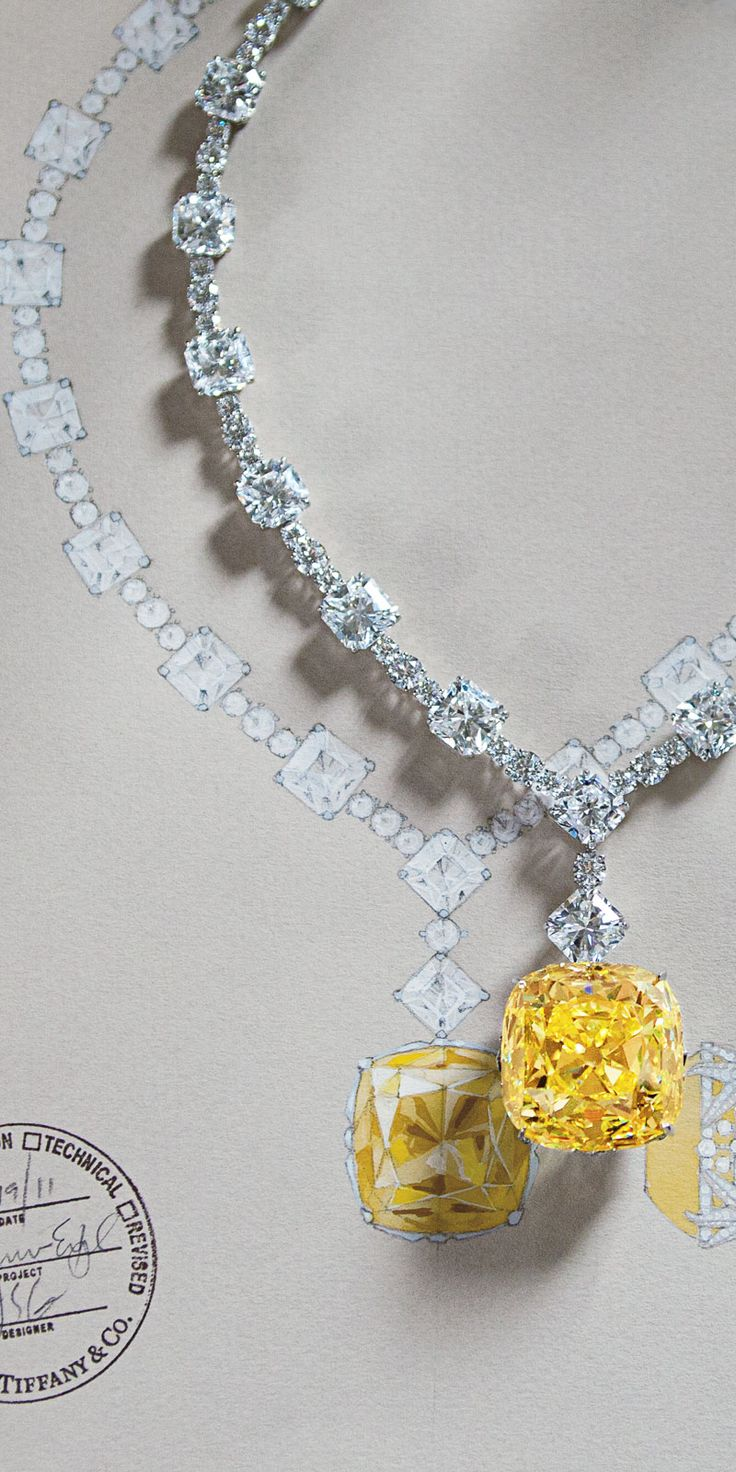 For Tiffany's 175th anniversary in 2012, the priceless Tiffany Diamond was reset in a magnificent necklace of white diamonds.The famous yellow Tiffany diamond in its new setting with the 128.54-carat yellow diamond and white diamonds totaling more than 120 carats. Via The Jewellery Editor.