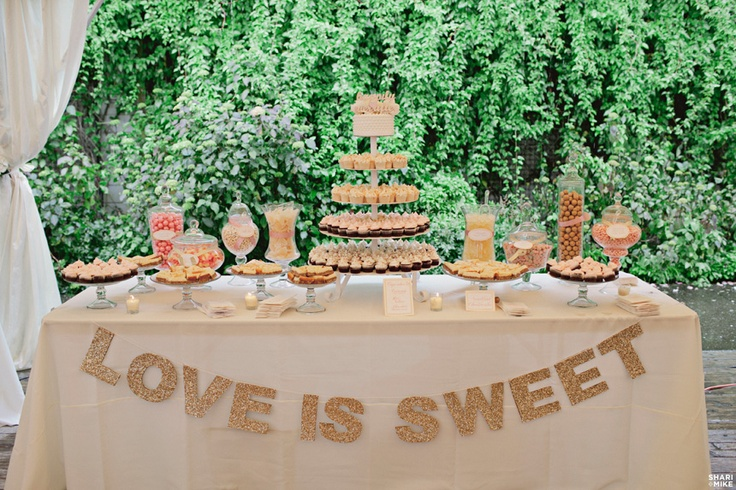"""Love is Sweet"" sign for dessert table. White letters would show up nice against a purple table linen."