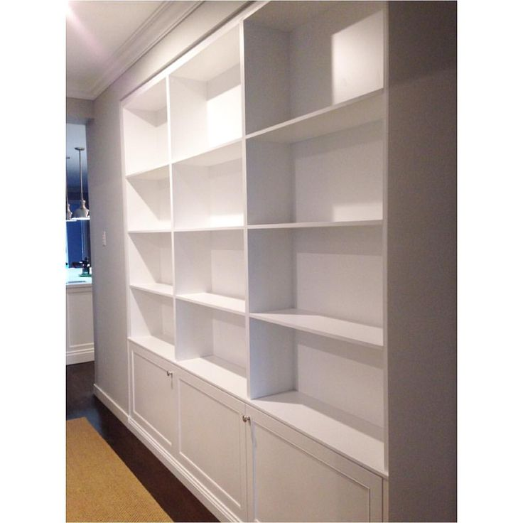 Built in book case. Custom cabinetry in hallway.  #hansensstyle #ourprojecthampton #cabinetry #shaker #bookcase #interiors