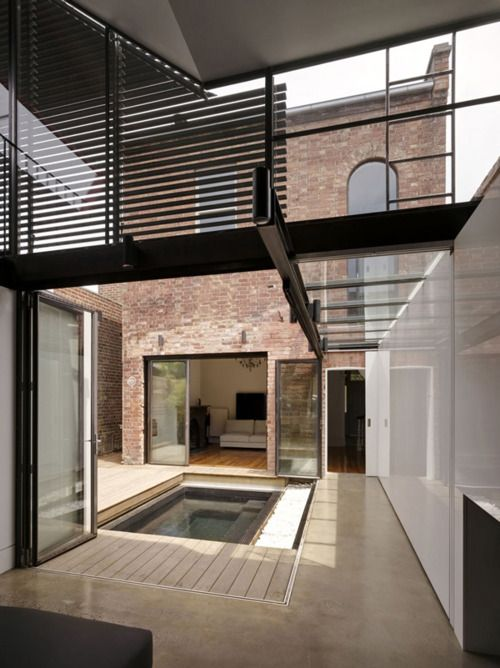 Love the use of courtyards to open a house