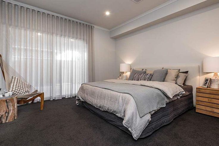 This spacious master bedroom is the perfect blend of style and comfort.#weeksbuildinggroup #newhome #homedesign