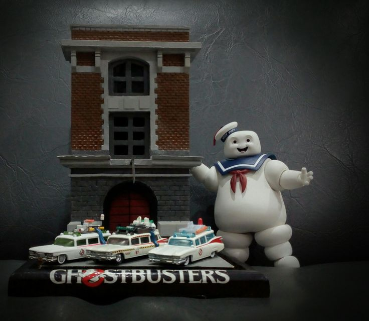 Line up of 1/72(?) Scale hotwheels Ghostbusters Ectos, with foam made HQ and SHF Marshmallow Man.
