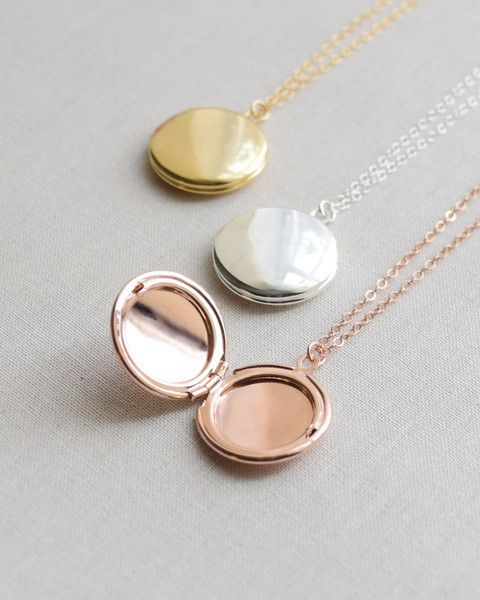 Olive Yew's Classic Round Locket Necklace is so beautiful and simple. Leave it blank or add an initial. Available rose gold, gold and silver.