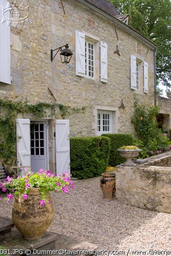 Really like the pea gravel and the shutters....lovely