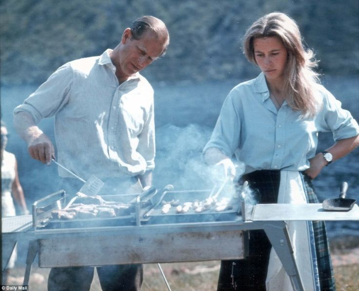Family barbecue: The Duke of Edinburgh turns his hand to cooking sausages with a little help from Princess Anne in this photo taken in 1972