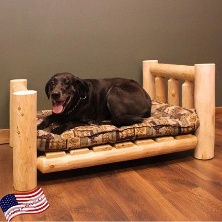 Rustic-style pet bed crafted from Northern white cedar. Made in the USA.  Product: Pet bedConstruction Material: