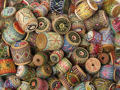 wrapped and stitched wooden spools.