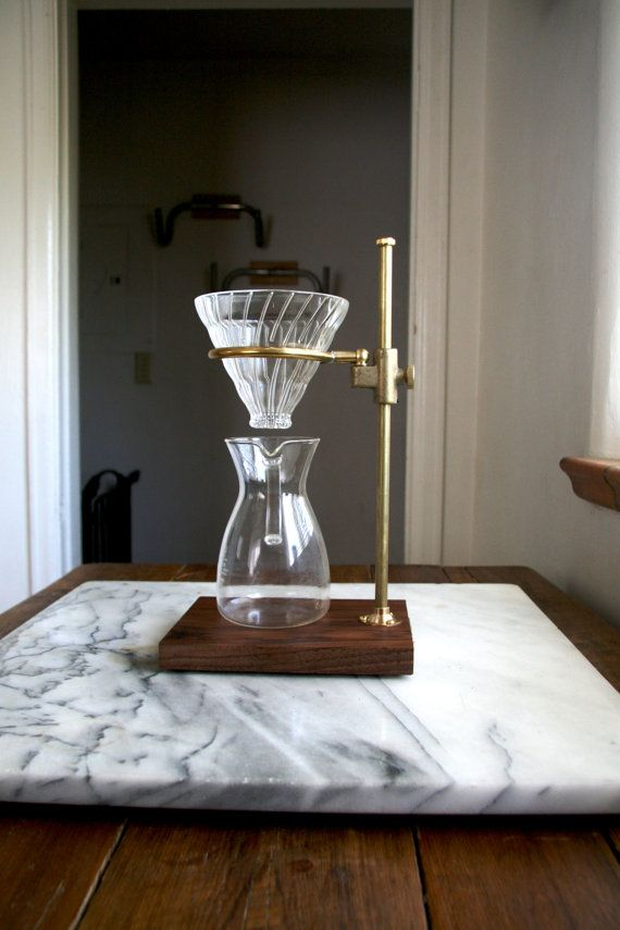 Crafted from brass in a lab style, The Clerk utilizes the Hario V60 glass pour over (included) resting on the ring to adjust to the height of
