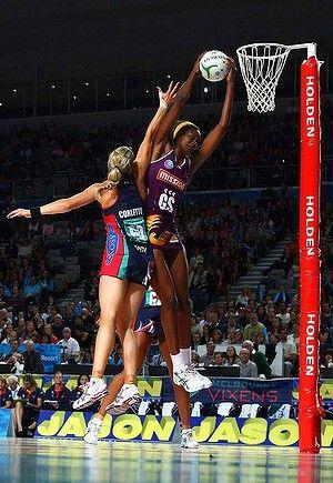 ANZ 2012 Tall order: Firebird Romelda Aiken gets the ball over Vixen Julie Corletto yesterday. http://www.goodnetballdrills.com/5-netball-defence-drills-tips-tactics/