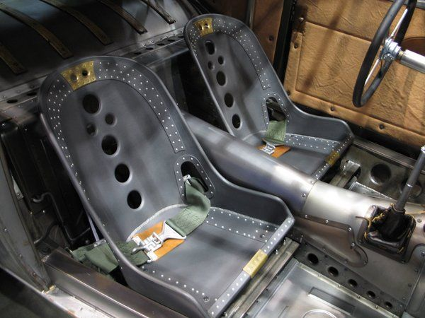 aluminum bomber seat with custom holes cut out the back.  hot rod made by Jay Stone