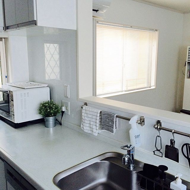 Towel rack above the kitchen sink to store and hand your dish towels and other items.