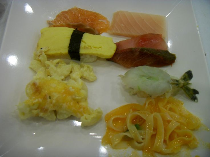 Salmon, raw tuna, egg sushi, raw fish, shrimp sushi, macaroni with cheese, noodle.