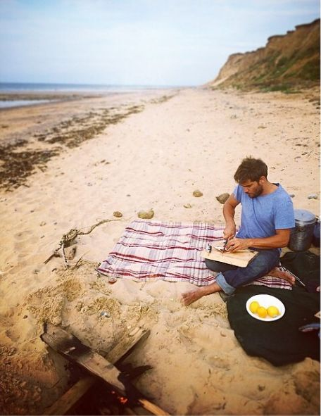 On the beach, oak smoking mackerel in an old army dixie pan, over a driftwood fire