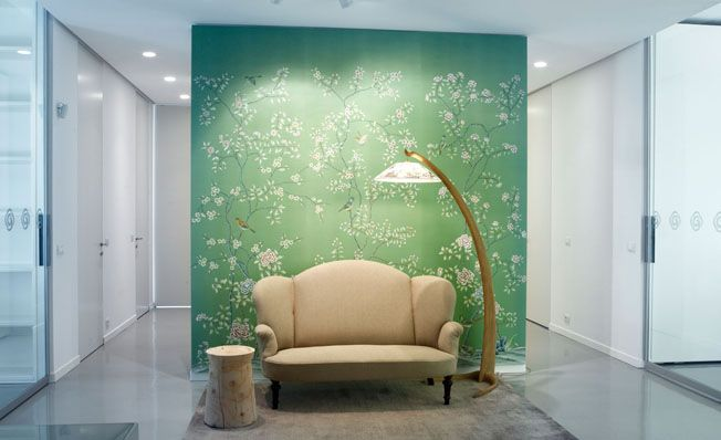 Modern chinoiserie 'Qing Dinasty Garden' by Misha wallpaper: Designer QU-Arch featured hand painted wallpaper Qing Dinasty Garden on Green Emerald silk in the client's office in Milan, Italy.