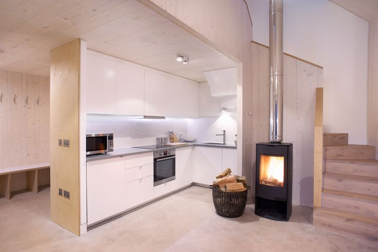 Architect designed holiday house in the Pentland Hills Regional Park near Edinburgh. Westside Woodshed build using CLT timber, with oak & plywood detailing  Architect: Roxburgh McEwan  Modern Architecture Scotland, Nominated for a Saltire Architecture Award  Stove: Aga Basket: Cox&Cox Paint/ oil: Osmo oil Flooring: Russwood Polished concrete floor