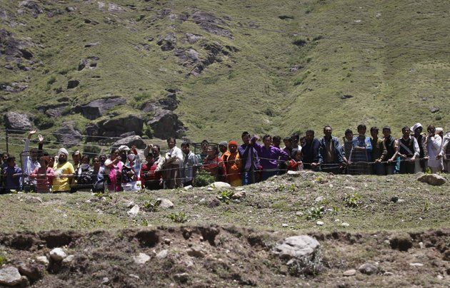 Survivors wait to board army helicopters during rescue operations at Badrinath in the Himalayan state of Uttarakhand June 21, 2013.