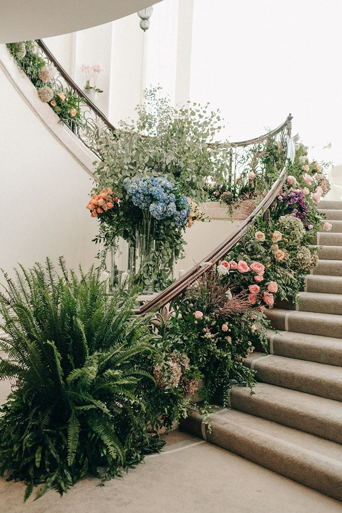 Abundant wedding day flowers. Flowers on stairs.