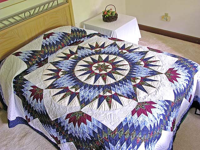 Mariner's Star. The pattern is from Shining Star Quilts by Judy Martin. This quilt photo is from the Amish Country Lanes web site.