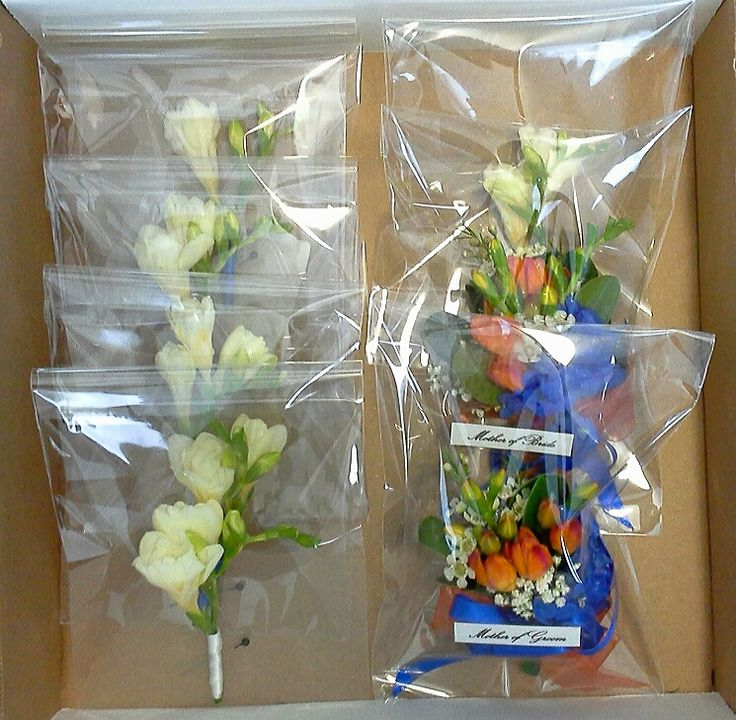 boutonnieres and corsages ready for delivery, August 8, 2014, Artscape Gibraltar Point, Toronto Island; design by Davis Floral Creations