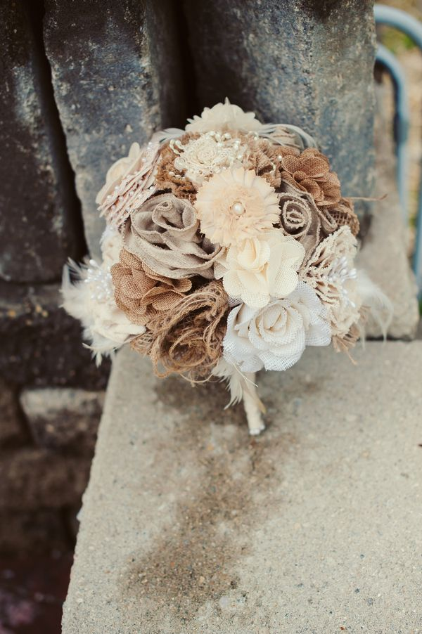 The bride carried a unique bouquet made entirely of burlap.  	Photo by Melissa Copeland Photography
