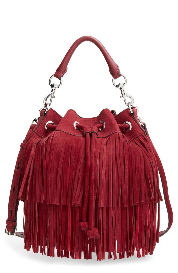 This versatile Rebecca Minkoff bucket bag boasts a fun boho look with swingy…
