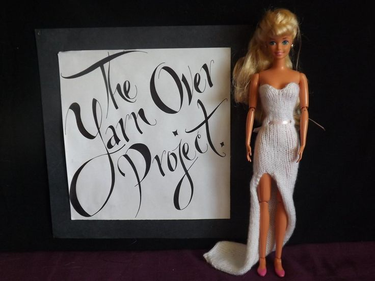 """Barbie is ready to walk down the aisle in this hand-knitted strapless wedding dress, featuring featuring a train and ribbon belt. Modeled by the 1994 Gymnastics Barbie, this dress is made to fit the standard 11.5"""" high Barbie doll from Mattel. The skirt is knit in the round for a seamless design, and to allow the dress to slide on easily over Barbie's hips. This dress is available as part of a Bridal Wear e-book!"""
