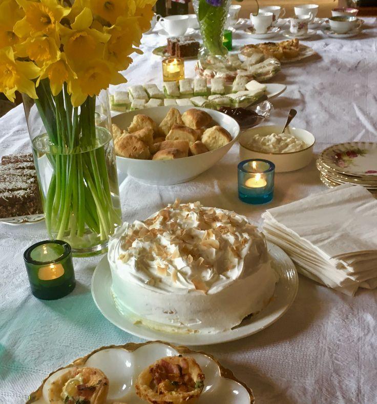 High Tea. Coconut cake with Italian meringue, scones, bacon egg tarts