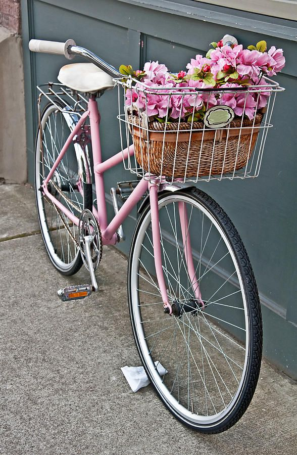 vintage-pink-bicycle-with-pink-flowers https://uk.pinterest.com/uksportoutdoors/dual-suspension-bikes/pins/