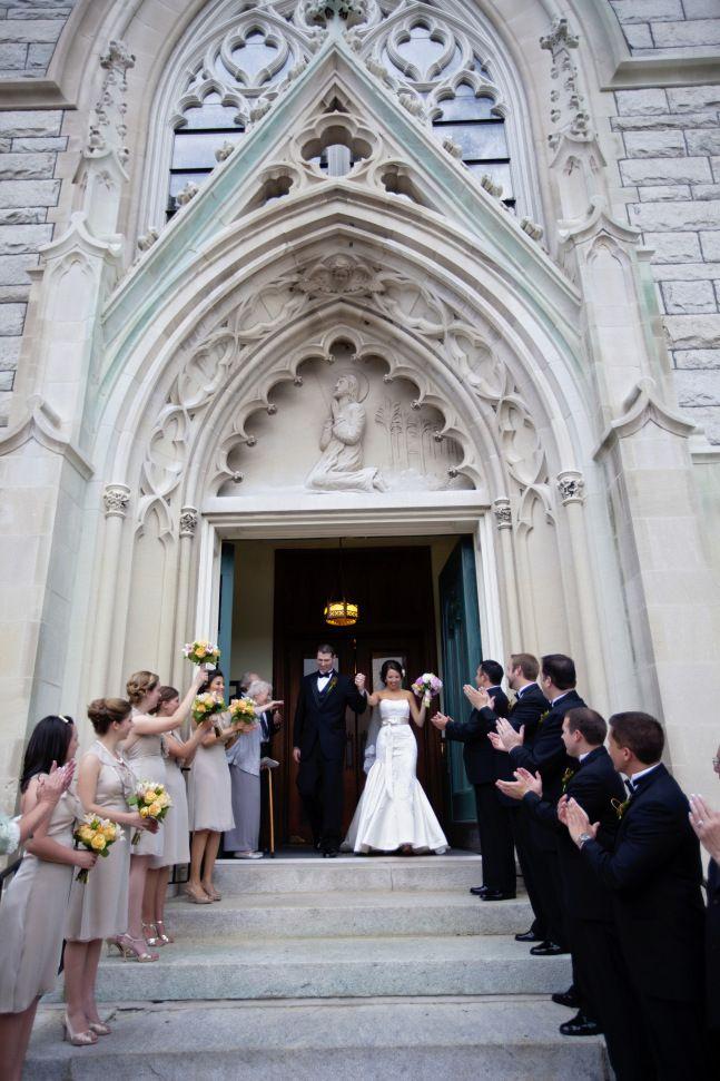 Our catholic wedding ceremony exit in Portsmouth, VA!  www.pineapplesandpeonies.com