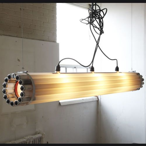 Design by Castor, 2005 - 2007.  This linear pendant light is a cylinder formed by bundling burnt-out fluorescent tubes together. The cylinder is then lit from within.
