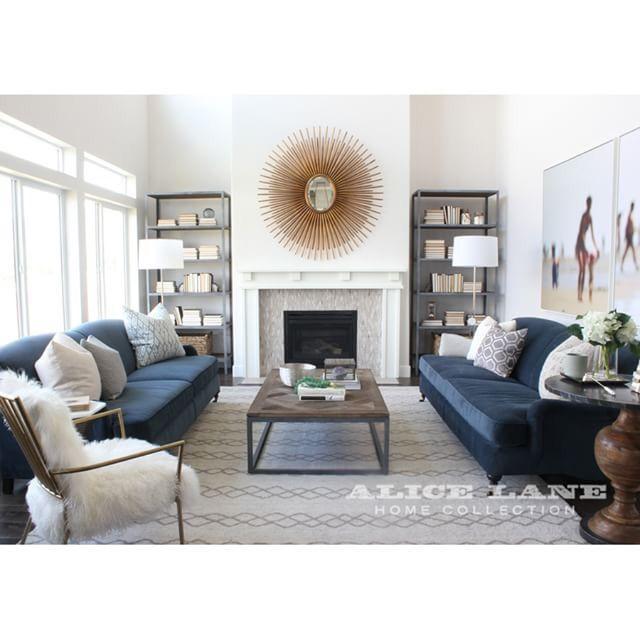 Midnight Blue Couch White Walls Starburst Mirror For