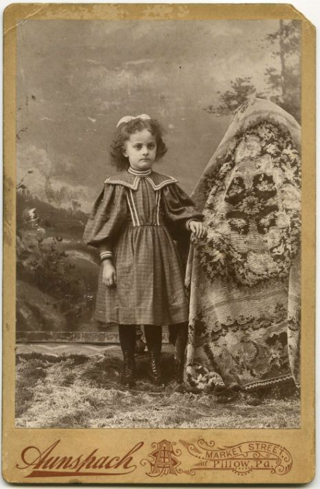 Another wonderful photograph of a Ghost mum. And for those who missed the first explanation: In the fledgling days of photography, one had to remain completely still for a length of time for a proper portrait to be taken. With a child's predilection for doing anything but standing still, their mothers would have to be in the photography to keep them still. For reasons I'm not sure of, the bright idea was to cover the matrons with fabric, thus creating the ghost mother.