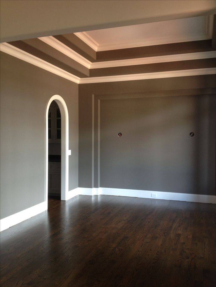 Sherwin Williams Gauntlet Gray walls with Pure White Trim and Jacobean stained red oak floors with a satin finish!!