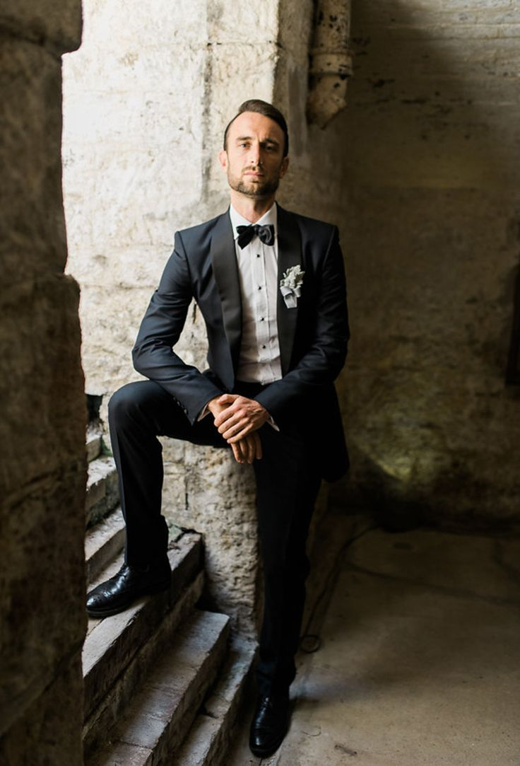 Navy groom suit with black bow tie and silver Dusty Miller buttonhole | Two People
