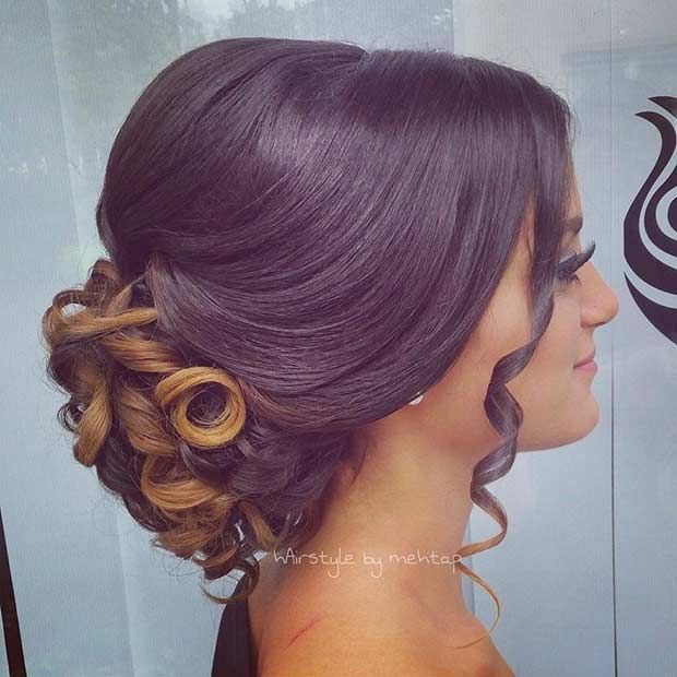 Curls?  Check.  Style?  Check.  Chic ?  Check.  This is all you need to look magnificent with this glamorous curly updo.