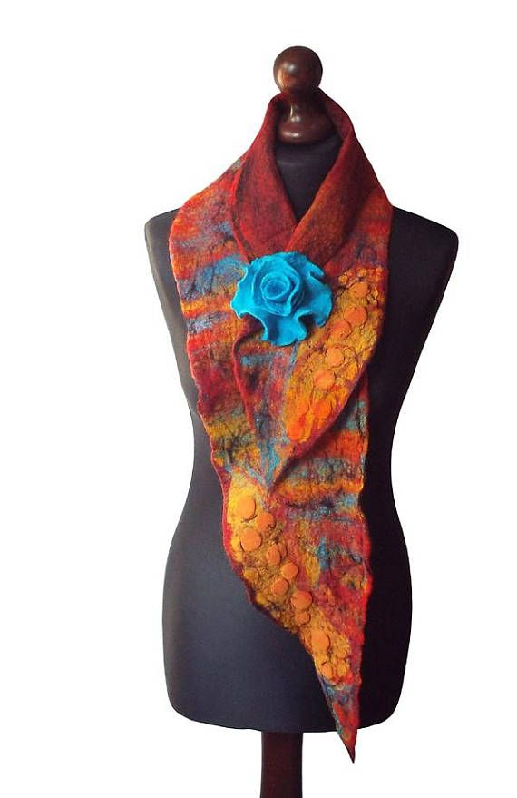 Nuno felted collar/ scarf made from finest Australian merino wool and hand dyed silk fabric. Handmade nuno felt technique. Collar with felted flower brooch - metal pin closure.  Size: length: 130cm (51,18) width: 11 - 22cm (4,33 - 8,66) Colors: multicolor - shades of orange, yellow, red, shades of turquoise, black.  Visit my fan page on Facebook: www.facebook.com/pracownia.artystyczna.arteduo  More scarves you can find here: www.etsy.com/shop/MarlenaRakoczy?section_id=...