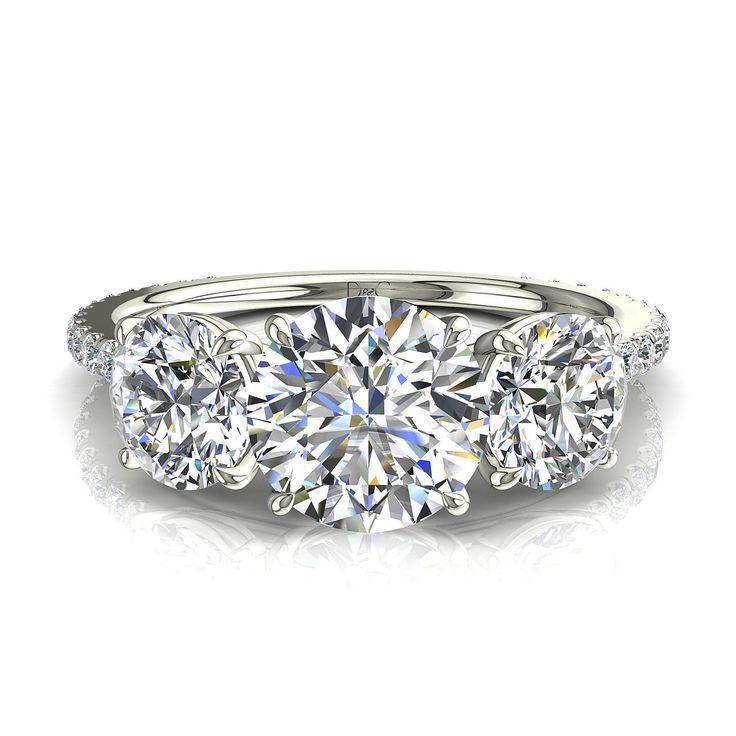 Bague de fiancailles diamants ronds or blanc 1,10 carat Azaria  Bague trilogie diamants or blanc sertie de 1,10 carats.Diamants et Carats vous propose Azaria , élégante bague diamants ronds en or blanc 18 carats. Fabriquée dans nos ateliers, cette bague diamants est montée sur or blanc, jaune ou rose 18 carats selon votre demande. Cette bague trilogie est sertie d'une pierre central de 0,40 carat ainsi que de deux diamants de 0,20 carat l'épaulant, pour un total de 1,10 carat.  * Couleur des…