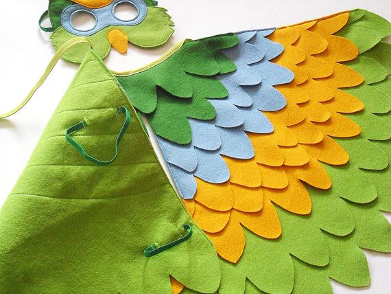 Bird costumes for the girls and daddy using either this idea, or no fray chanille to create wings and a feather patch (using feather boas) on the front of their shirts OR same fabrics and backward apron tails. Girls wagon becomes a nest. Mom is a bird watcher.