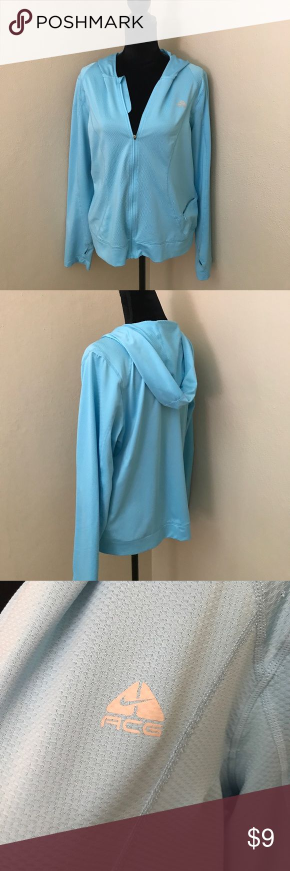 """Baby Blue Hoodie Gently used hoodie great for walks on brisk mornings, breathable weave, poly/spandex blend, machine wash cold. Zipper pocket for ID and keys, thumb holes at end of each sleeve. Small stain on right elbow (see picture). Measures 24"""" shoulder to hem and 22"""" across chest. Zippers work fine. Bundle and save! Smoke free home. Nike ACG Jackets & Coats"""