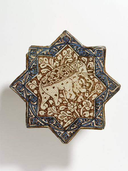 Tile Place of origin: Kashan, Iran (probably, made) Date: early 14th century (made) Artist/Maker: unknown (production) Materials and Techniques: Fritware, glazed and painted in cobalt blue and lustre Museum number: 1493-1876