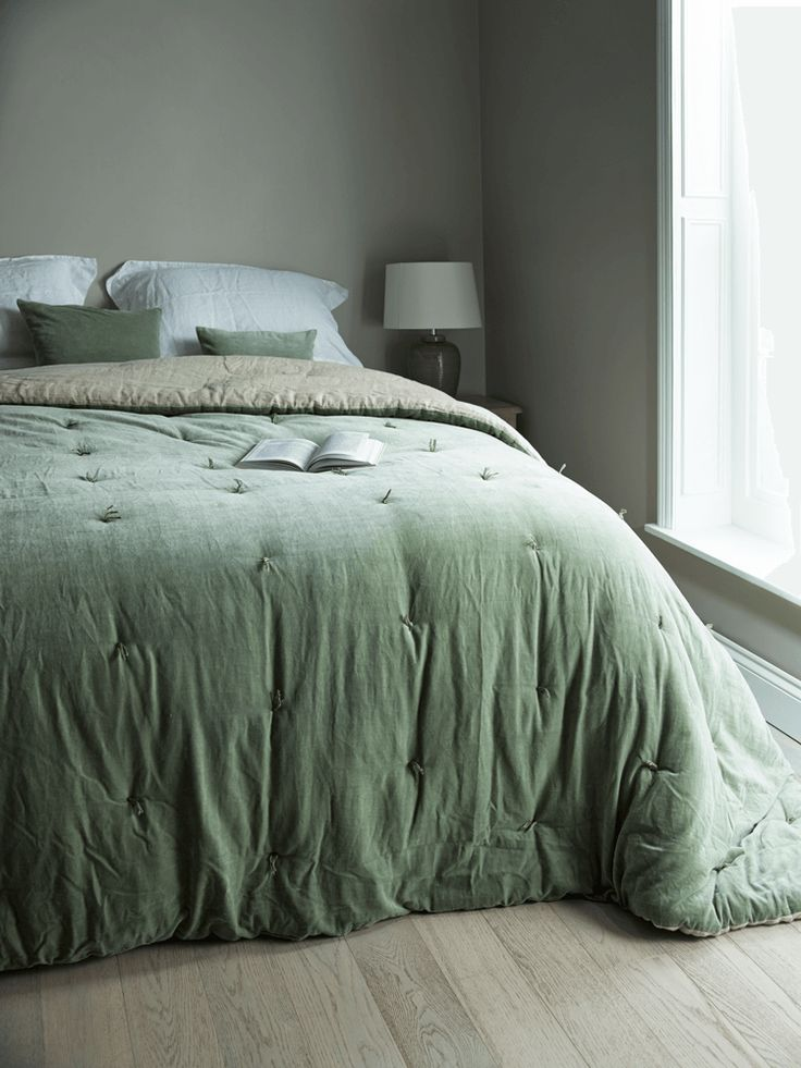Sage green velvet throw from Cox and Cox | Get Your Hygge On - Mad About The House