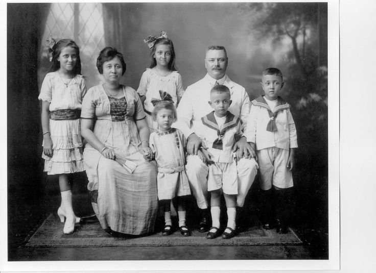 My mother, youngest in the picture, with her Dutch father and Dutch-Indonesian mother, in Soerabaja, Indonesia, 1924.