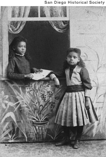 Two young African American girls near an open window Date: [ca. 1898] 1893/1903
